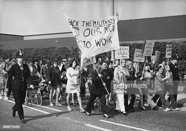 The wives of laidoff workers protest against a strike by 150 internal transport drivers at the British Leyland car plant in Cowley Oxford which has...