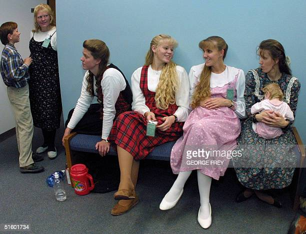The wives of Utah polygamist Tom Green wait during jury selection at 4th District court 14 May 2001 in Provo Utah For the first time in 50 years the...