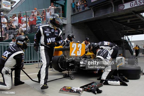 The Wix Dallara Honda driven by Paul Tracy of Canada is serviced after crashing during the IZOD IndyCar Series Indianapolis 500 Mile Race at...