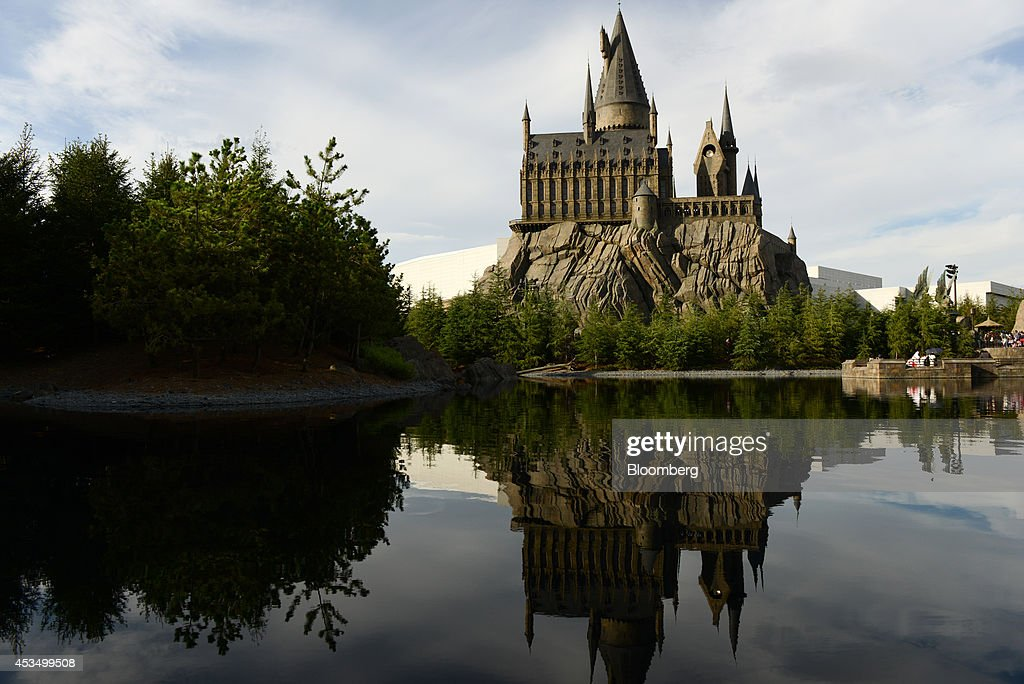 The Wizarding World of Harry Potter themed area stands at Universal Studios Japan, operated by USJ Co., in Osaka, Japan, on Thursday, Aug. 7, 2014. USJ is counting on its cachet turning around a failing Universal Studios theme park in Japan to win a partnership with a foreign casino operator. As the country edges nearer to legalizing gambling resorts, the company is in talks with MGM Resorts International, Caesars Entertainment Corp. and Genting Bhd. for a possible tie-up, Chief Executive Officer Glenn Gumpel said in an interview. Photographer: Noriko Hayashi/Bloomberg via Getty Images