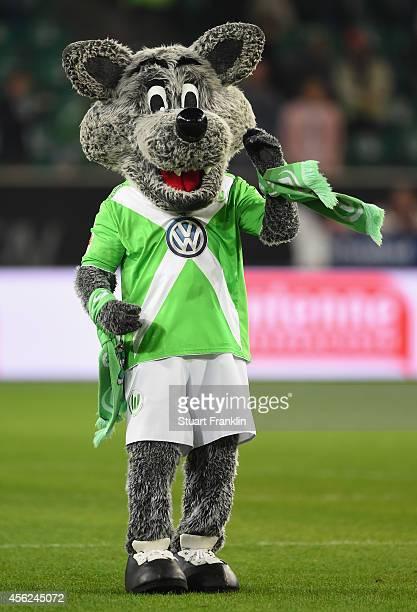 The Wolfie mascot of Wolfsburg celebrates after the Bundesliga match between VfL Wolfsburg and Werder Bremen at Volkswagen Arena on September 27 2014...