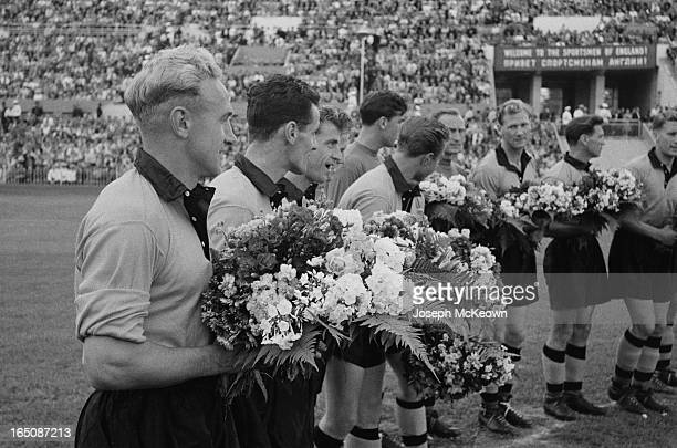 The Wolverhampton Wanderers football team being presented with flowers before playing Spartak Moscow in Moscow, 7th August 1955. Wolves captain Billy...