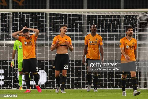 The Wolverhampton Wanderers players look dejected after Sevilles goal during the UEFA Europa League Quarter Final between Wolves and Sevilla at MSV...