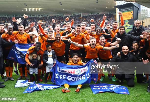 The Wolverhampton Wanderers team celebrate victory and promotion to the Premier League after the Sky Bet Championship match between Wolverhampton...