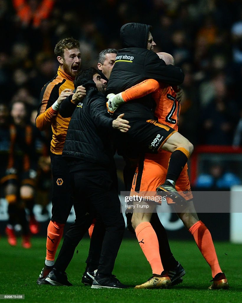 The Wolves players celebrate as Ryan Bennett of Wolverhampton Wanderers(not pictured) scores his sides winning goal during the Sky Bet Championship match between Bristol City and Wolverhampton Wanderers at Ashton Gate on December 30, 2017 in Bristol, England.
