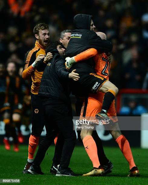 The Wolves players celebrate as Ryan Bennett of Wolverhampton Wanderers scores his sides winning goal during the Sky Bet Championship match between...