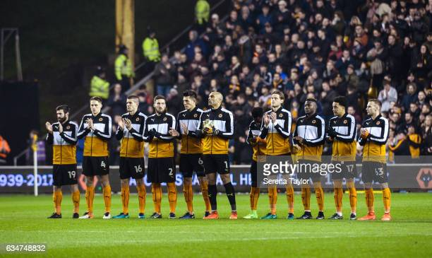The wolves team stand on the pitch for a minutes applause prior to kick off of the Sky Bet Championship match between Wolverhampton Wanderers and...