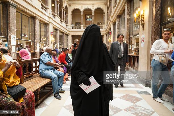 The woman being fined for wearing a face covering veil in public forbidden in France and Belgium visited the townhall of Schaarbeek a community of...