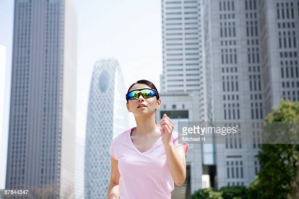 The woman is running in the city.