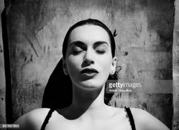 the woman lies on a board, with parted lips, and a small butterfly on the head - beauty queen stock pictures, royalty-free photos & images