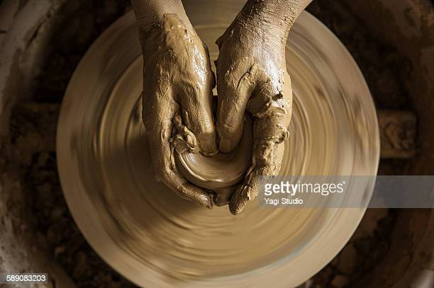 The woman using the potter's wheel in pottery