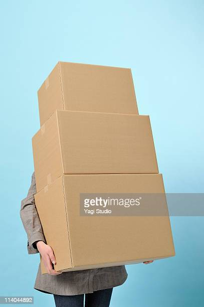 the woman who has corrugated cardboard - cardboard box stock pictures, royalty-free photos & images