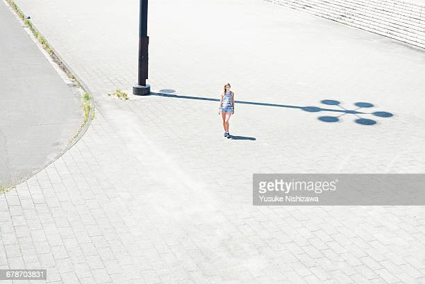 the woman who walks the park - yusuke nishizawa stock pictures, royalty-free photos & images