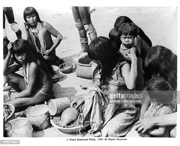 The women and children of a tribe in their village in a scene from the documentary film 'Macabro' 1967