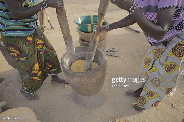 The women crush the corn