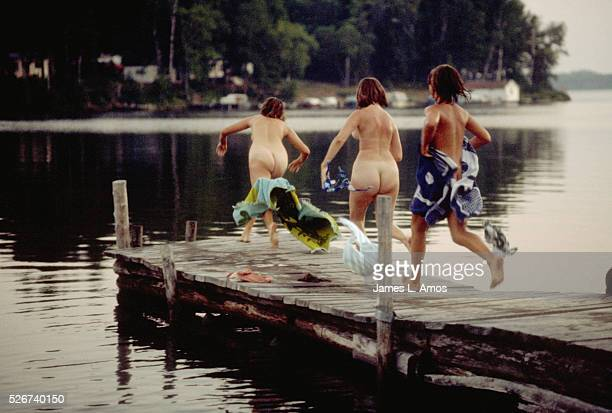 The women of a Finnish family the Kittis jumping into cold lake following Saturday night sauna bath Keeweennaw County | Location Keeweennaw County...