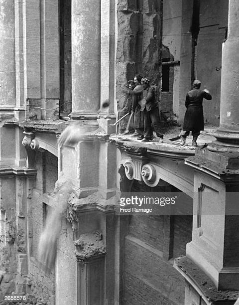 The women of Dresden clearing debris from the floor of the Zwinger art gallery during postwar rebuilding of the bombdamaged city