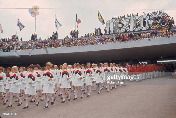 The women of the United States Olympic team lead their male counterparts into the University City Olympic Stadium during the opening ceremonies of...
