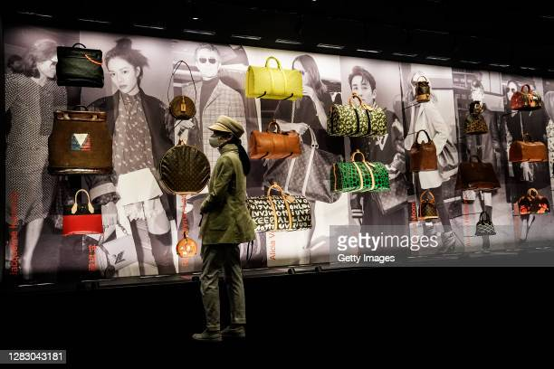 "The women wear a mask while visit during new Louis Vuitton traveling exhibition ""SEE LV"" Opening ceremony at Wuhan International Plaza on October 30,..."
