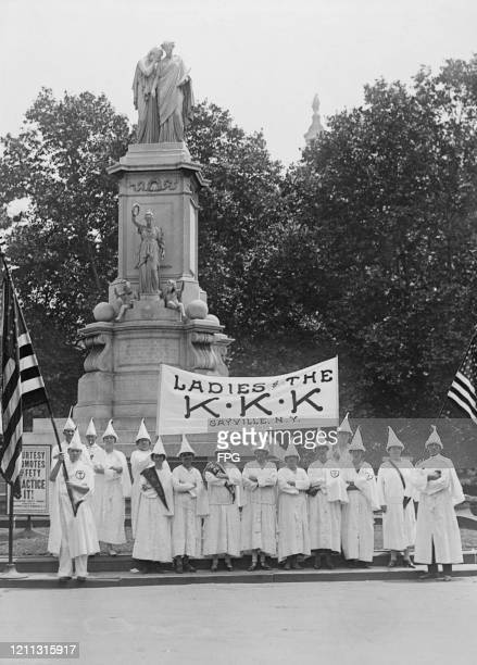 The women's auxiliary of the Ku Klux Klan of Sayville at the Peace Monument in Washington DC where they are participating in a Ku Klux Klan parade US...