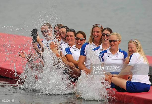 The women's eight rowing team of Great Britain splash water as they pose for photographers on the docks at the Shunyi Olympic Rowing-Canoeing Park...