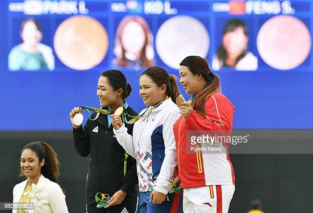 The women's golf gold medalist Park In Bee of South Korea silver medalist Lydia Ko of New Zealand and bronze medalist Feng Shanshan of China pose...