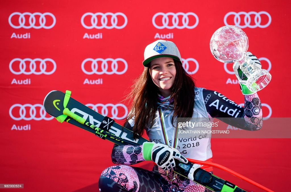 The women's overall season's Super-G winner Liechtenstein's Tina Weirather poses with her cristal globe on the podium after the FIS Downhill World Cup final event in Aare, Sweden, on March 15, 2018. / AFP PHOTO / Jonathan NACKSTRAND