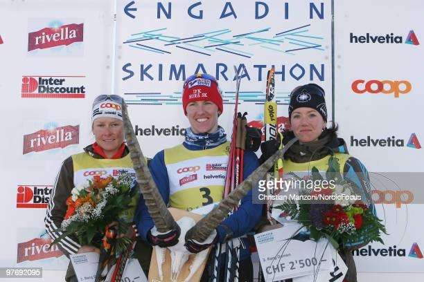The women's podium with Seraina Mischol of Switzerland taking second place winner Susanne Nystroem of Sweden and Selina Gasaparin of Switzerland...
