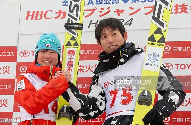 The women's winner Yuki Ito and men's winner Daiki Ito pose for photogrpahs during the Ski Jumping HBC Cup at Okurayama Ski Jump Stadium on January...