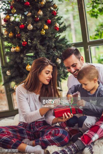 the wonder of christmas morning - pinaceae stock pictures, royalty-free photos & images