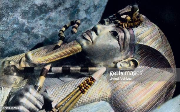 The wonderful genuine gold created King Tut's mummy's head of Amun from whose grave is all valuable come to the museum While the face and hands made...