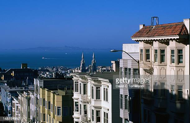 The wonderful houses of Nob Hill looking over to the bay and the spires of Sts Peter and Paul in San Francisco.