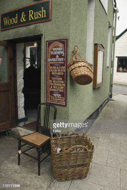 The Wood And Rush basketry shop which is selling traditionally made chairs and baskets made from willow rush and cane Chagford Devon England May 1997