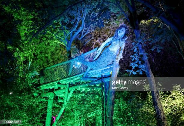 The Wood area is illuminated at night at the 2019 Glastonbury Festival held at Worthy Farm, in Pilton, Somerset on June 26, 2019 near Glastonbury,...