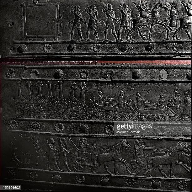 The wooden gates of Shalmaneser III with bands of relief decoration in bronze The top detail shows porters and Assyrian officers The bottom detail...