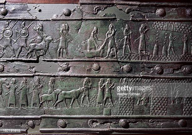 The wooden gates of Shalmaneser III with bands of relief decoration in bronze The top shows the king discovering the source of the River Tigris The...