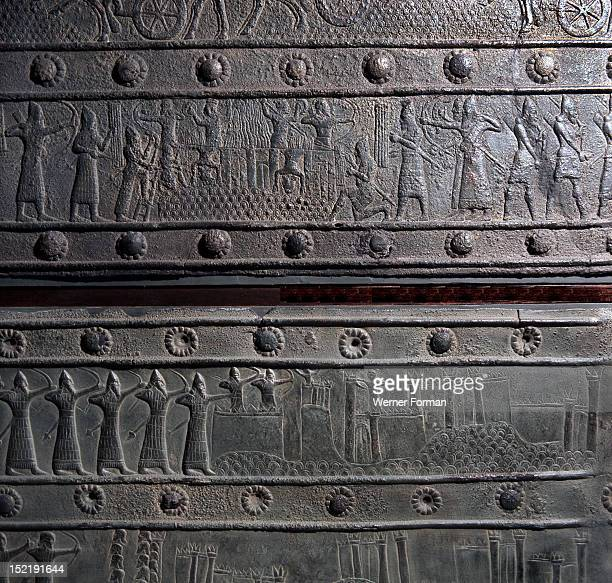 The wooden gates of Shalmaneser III with bands of relief decoration in bronze The details are from the Assyrian assault on the city of Khazazu...