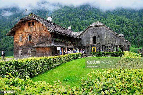 the wooden house at koenigssee - königssee bavaria stock photos and pictures