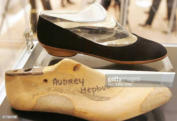 The wooden last of actress Audrey Hepburn's foot and a shoe are displayed an exhibition A Love Affair with Shose held by Italian luxury fashion giant...