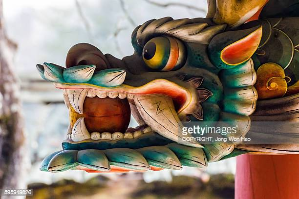 The wooden oriental dragon with the ball in the mouth