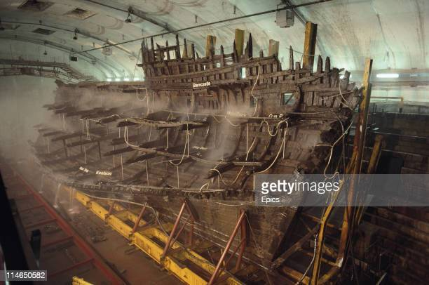 The wooden wreck of the Mary Rose warship is kept wet whilst undergoing conservation in the ship hall Portsmouth July 1987 The Mary Rose was salvaged...