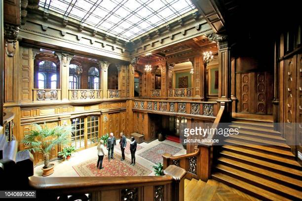 The wood-panelled stairwell at Schloss Waldenburg palace, in Waldenburg, Germany, 29 April 2015. Since 2005, 8.5 million euro has been spent on...