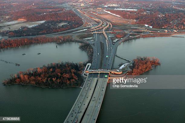 The Woodrow Wilson Bridge, part of the Capital Beltway, touches on Rosilie Island in the Potomac River February 26, 2014 in Fort Washington, Maryland.