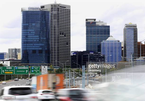 The Woodside Petroleum Ltd logo is displayed atop the company's new headquarters left and Woodside Plaza building third right in Perth Australia on...