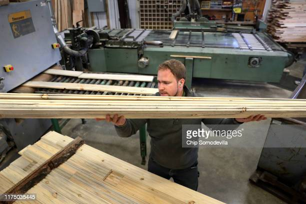 The Woodworkers Shoppe employees Michael Yoder stacks sanded boards of custom tongueandgroove flooring made from mountain pine beetlekilled ponderosa...