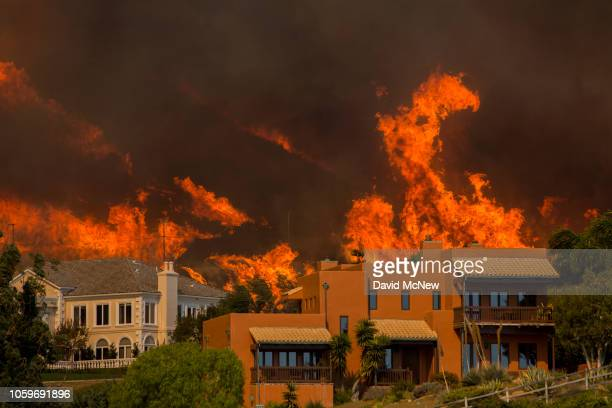 The Woolsey Fire approaches homes on November 9 2018 in Malibu California About 75000 homes have been evacuated in Los Angeles and Ventura counties...