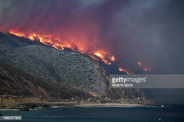 The Woolsey Fire reaches the ocean along Pacific Coast Highway near Malibu California November 9 2018 About 75000 homes have been evacuated in Los...