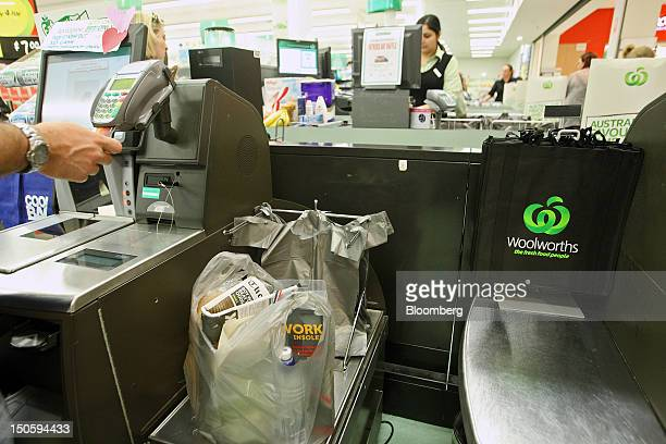 The Woolworths Ltd logo is displayed on a reusable shopping bag at a selfservice checkout counter at one of the company's supermarkets in Perth...