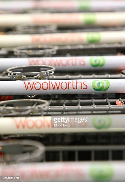 The Woolworths Ltd logo is displayed on shopping trolley handles at one of the company's supermarkets in Perth Australia on Wednesday Aug 22 2012...