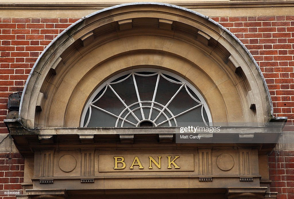 The word bank is displayed on an entrance to a branch of HSBC on March 3 2008 in Glastonbury, United Kingdom. HSBC, the UK's largest bank, has said it has made a 8.7bn GBP loss, after the decline in the US housing market hit the value of its loans. The bank's losses are said to be the biggest write-down of the UK's big five because it has a lot of business and operations in the USA, however its annual profits still rose 10 percent to 12.2bn GBP, up from the year before.